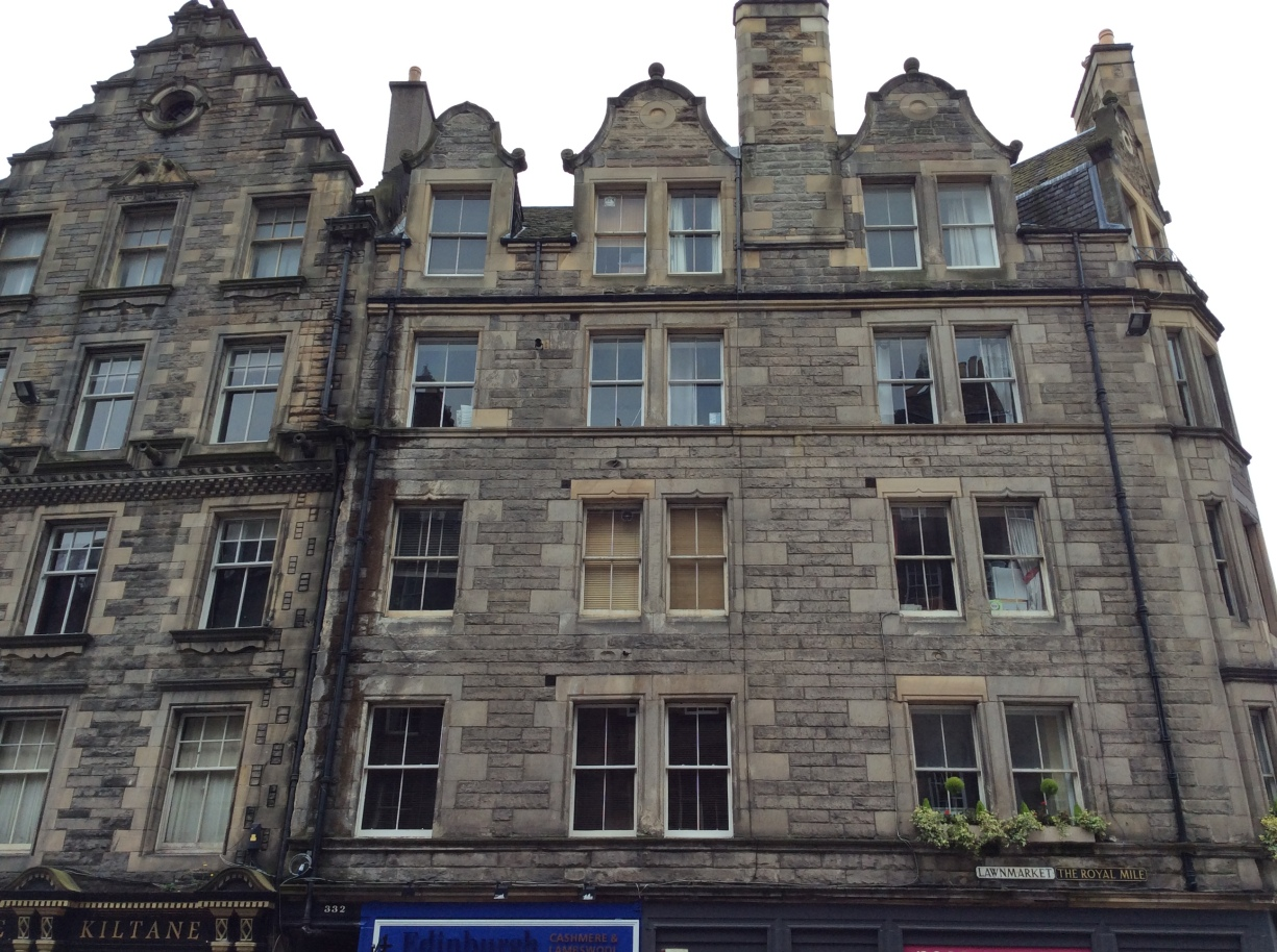 Tenements on the Royal Mile at Lawnmarket. 'Tenements' used to just refer to apartment buildings; the term gained its negative connotation later
