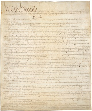 Constitution of the United States, first page of the original, provided by the National Archives and Records Administration, public domain via Wikimedia Commons