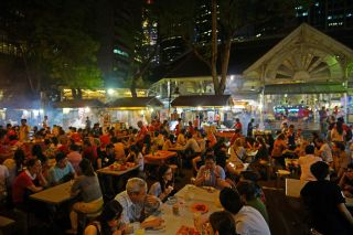 Singapore, Satay stalls along Boon Tat Street next to Telok Ayer Market by Allie Caulfield, Public Domain via Wikimedia Commons