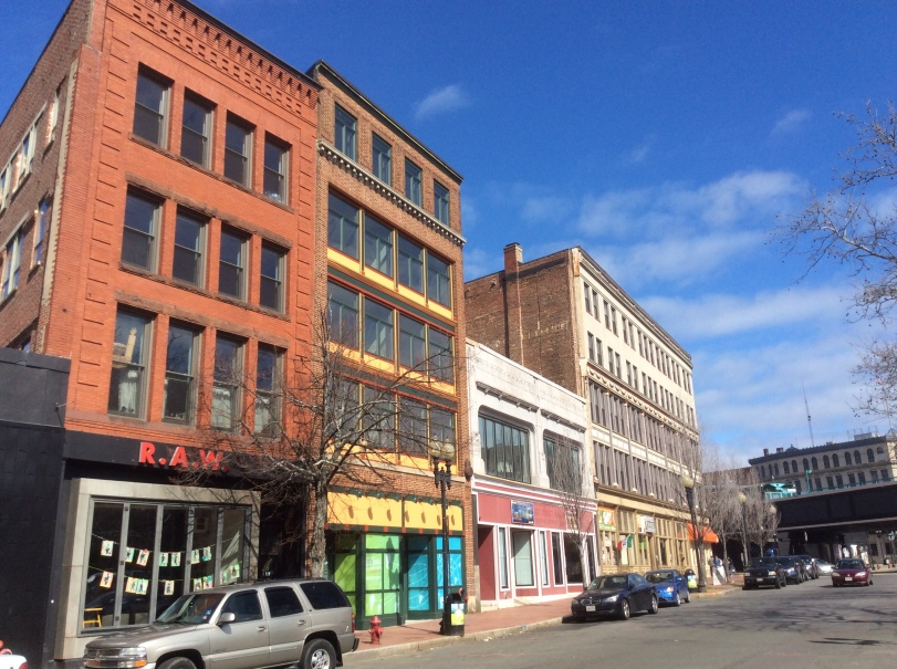 A row of buildings on Central Square in Lynn, MA