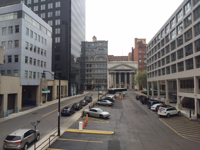 View from west end of Corinthian St, showing site of old Corinthian Hall at right where the glassy midcentury building now stands, photo 2016 by Paige Sloan