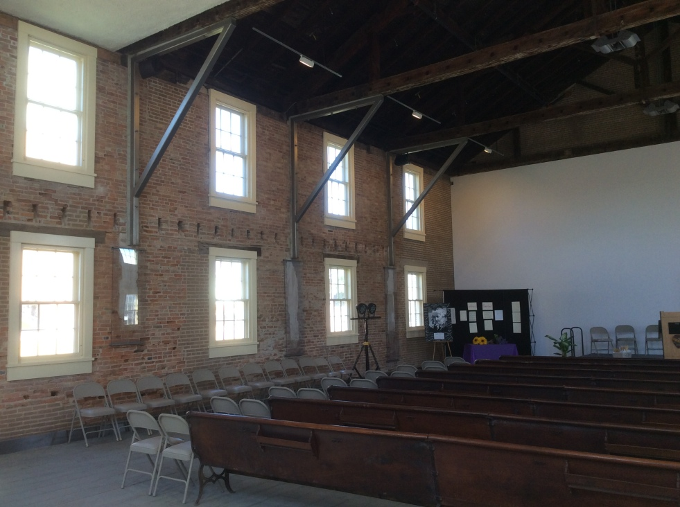 Interior of the rebuilt and restored Wesleyan Church. It went through several remodels and incarnations as various businesses, but much of the original brickwork remained, including some of the original plaster underneath layers of paint and later interior walls