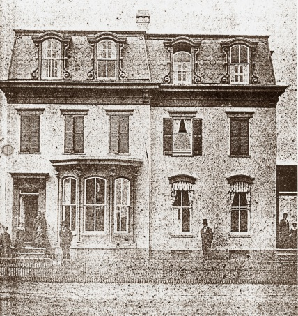 Frederick Douglass standing in front of his home at 320 A Street NE, Washington, DC, in 1876. Public domain via NPS