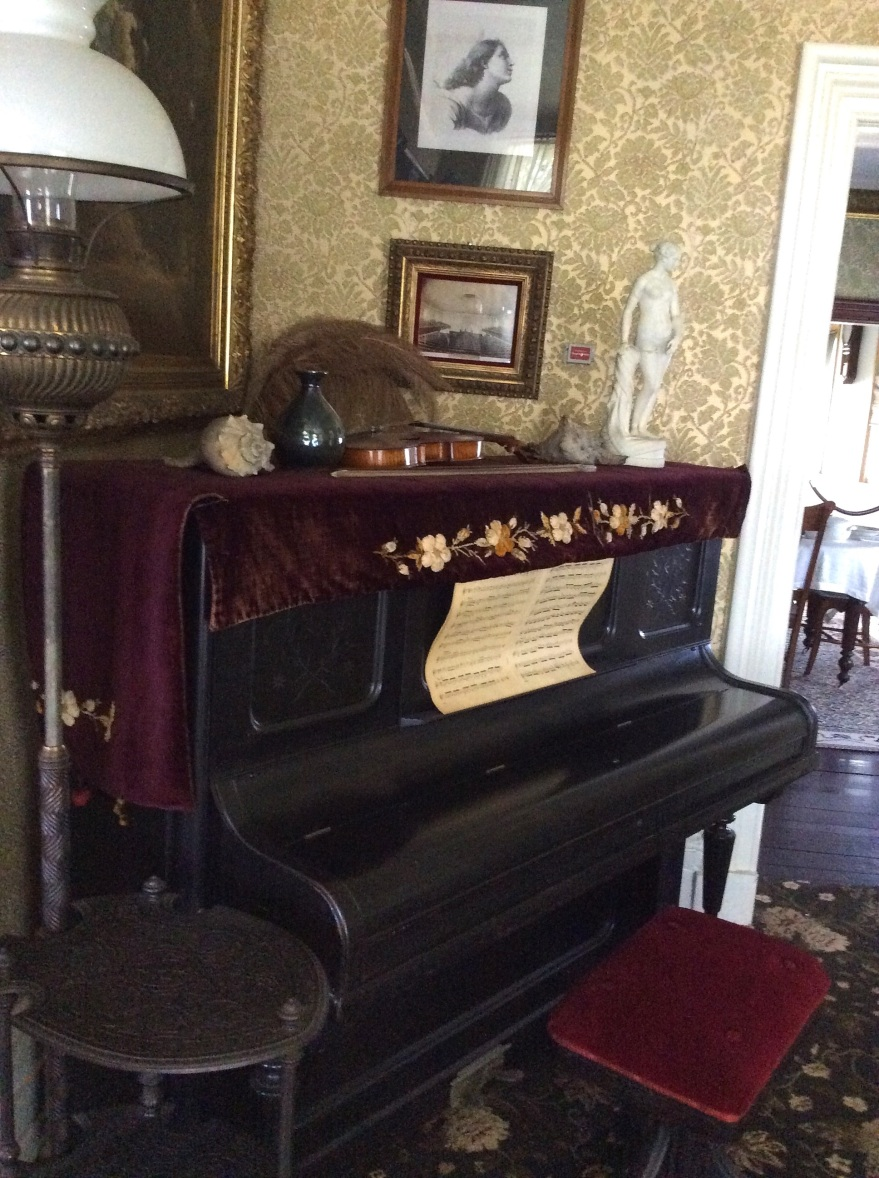 Sitting room piano with Joseph Douglass' violin on top