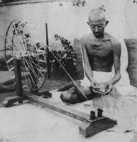 Mahatma Gandhi spinning yarn in the late 1920's. Gandhi started the ultimate 'Shop Local' movement, in which he called on his fellow Indians to wear only homespun, locally made fabrics to counteract the British colonialist's exploitation of Indian textile worker