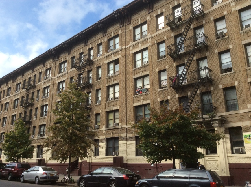 Apartment buildings which include 34 Post Ave near Dyckman St, NYC, 2016 by Amy Cools