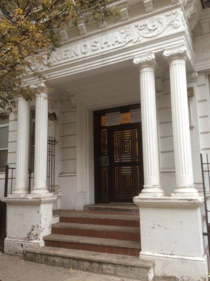 Porch of the Kenosha building at 141 W. 111th St, Harlem, NYC